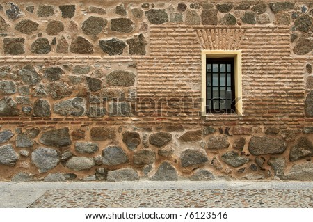 Stone wall with window and street (horizontal)