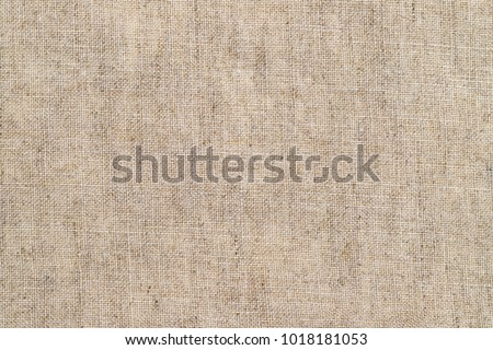 Stone washed pure linen texture. Wrinkled linen fabric background. Light natural linen texture background