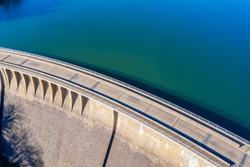 stone water dam in the sun from above