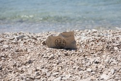 Stone with pictogram from numbers on the beach