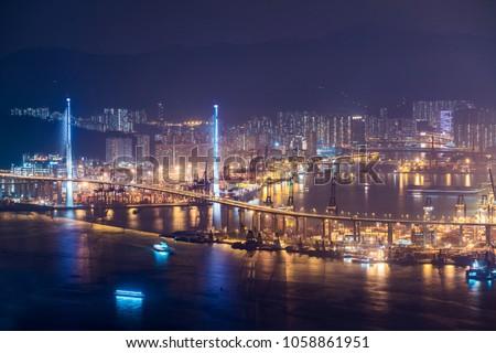 Stonecutters bridge, Hong Kong city at night.