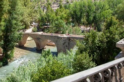 Stoned bridge over Júcar river with clean water in Alcalá del Júcar, one of the most beatiful spanish villages in Albacete, Castile La Mancha.