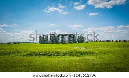 Stonehenge unesco world heritage site on sunny day, Salisbury in England. Summer holidays destination in the UK, Europe. Green countryside landscape with blue sky on a summer day in Great Britain.