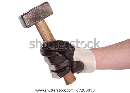 stonemason���´s hammer in working hand with glove.