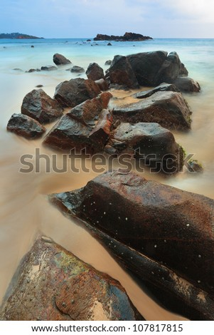 stones and boulders on the beach after sunset, Sri Lanka