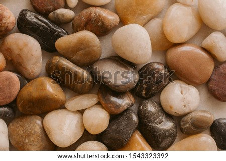 Stones and pebbles as background. Multicolor pebbles at the seaside close up view.
