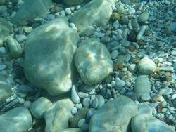 Stones and pebbles underwater in Aegean Sea