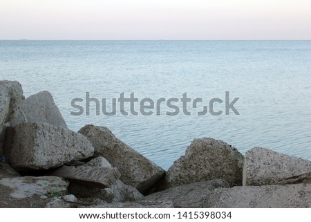Stones and sea at dawn on a summer day #1415398034