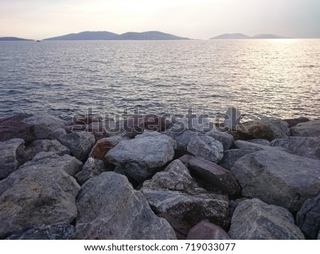 Stones and sea view with sunset
