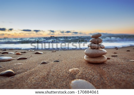 Stones balance on beach, sunrise shot  #170884061