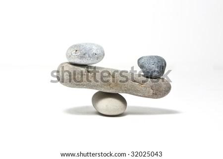 stones balance on flat stone bridge on white