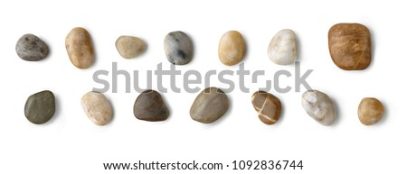 Stones collection. Different kind of pebbles stones with a soft shadow against white background.