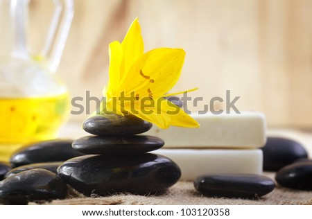 stones for spa and yellow flower