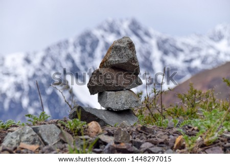 Stones in equilibrium, pile of rocks in the mountain, concept of balance and harmony.