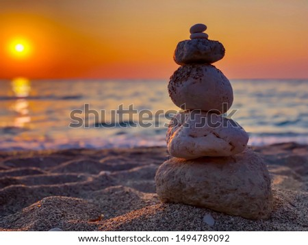 Stones in perfect balance during a sunset