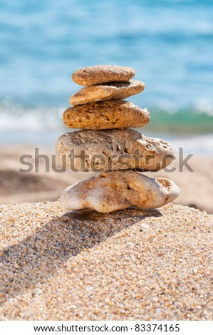 Stones in the sand close up. Concept for rest, spa, relaxation, resorts.