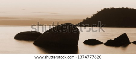Stones in the sea make the silhouette of the evening even more beautiful #1374777620