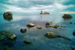 Stones in the seashore with Cloud