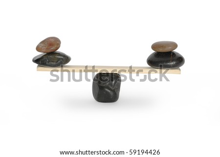 Stones lying on seesaw isolated on white background with clipping path