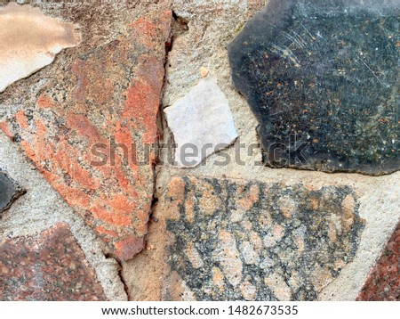 Stones of different colors, background. Old stone wall. Rough masonry cobblestones. Old stone wall. Rough masonry cobblestones.