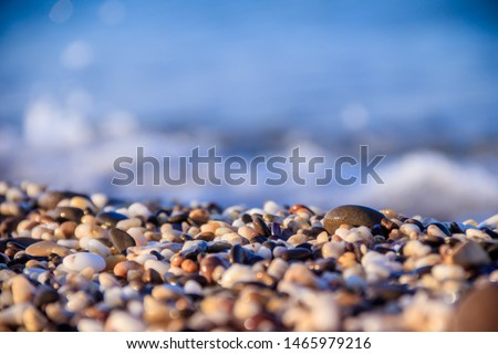 Stones on a background of a sea wave. Background stones and wave. Sea wave. Galichny beach. #1465979216