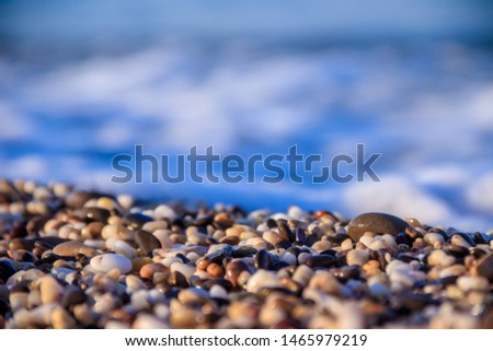 Stones on a background of a sea wave. Background stones and wave. Sea wave. Galichny beach. #1465979219