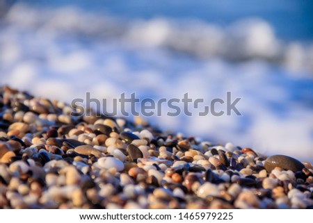 Stones on a background of a sea wave. Background stones and wave. Sea wave. Galichny beach. #1465979225