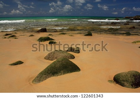 Stones on exotic, tropical, sandy beach