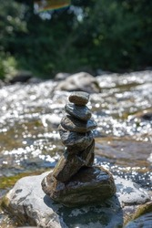 Stones on the river. Chaotically built stones. Smooth stones near the river