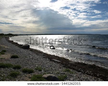 stones on the seashore, rocky seashore #1441262315