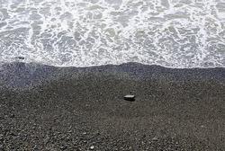 Stones on the seashore, stones on the beach.