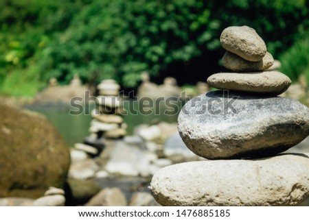 Stones perfectly balanced in a river in Bali