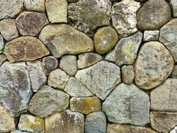 Stones perfectly placed in the wall of ancient ruins of Inca city Pumapungo at Cuenca, Ecuador, South America