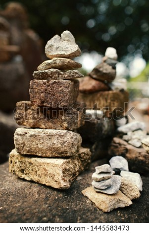 Stones pyramid,balance and wellness spa concept, zen like and well being tranquil composition. #1445583473
