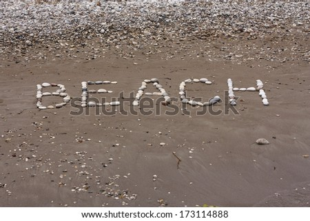 Stones sea background in wet sand of beach in sunny day photo #173114888