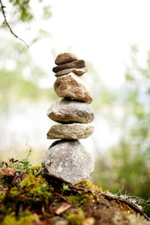 Stones stacked up on one another in the wild