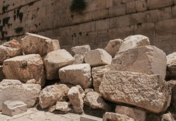 stones thrown by the romans from the second temple to the street below after the destruction of the temple in 70 CE with the Western Wall in the background