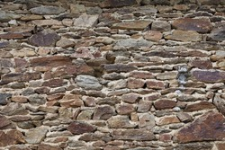Stonewall scarp, exterior wall made from surrounding rock