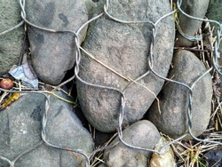 stonework background with wire fence