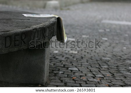 Stony bench and road covered with stones in Zurich