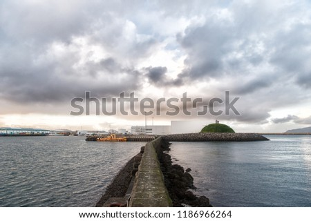 Stony breakwater in sea. Breakwater surround docks, ports and lagoons. Breakwater function concept. Breakwater scandinavian seascape. Pier sea fortification. Coastal defence and fortification.