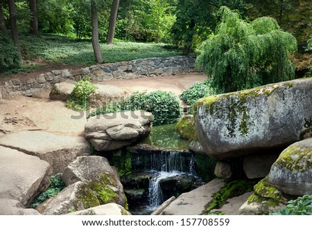 Stony landscape. Waterfall in the park.