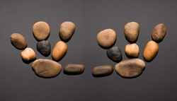 Stony prints of the right and left hand are made up of various pebbles
