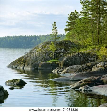 Stony shore of Ladoga lake at morning, Karelia, Russia