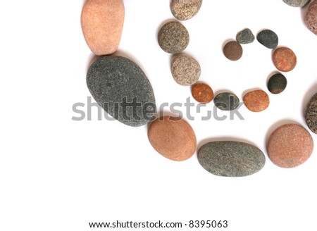Stony spiral. Abstract background made from pebbles, on white