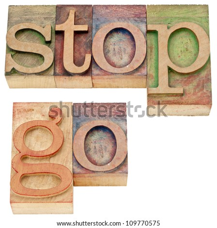 stop and go - isolated words in vintage letterpress wood type