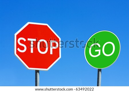 Stop and Go sign against a blue sky