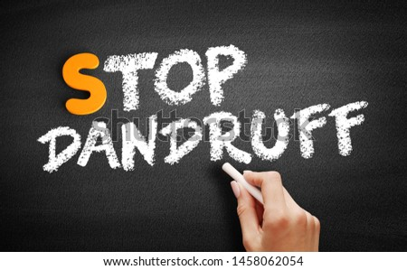 Stop Dandruff text on blackboard, medical concept background #1458062054