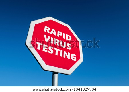 Stop for Rapid COVID-19 Virus Testing transportation sign in perspective view against blue sky Сток-фото ©