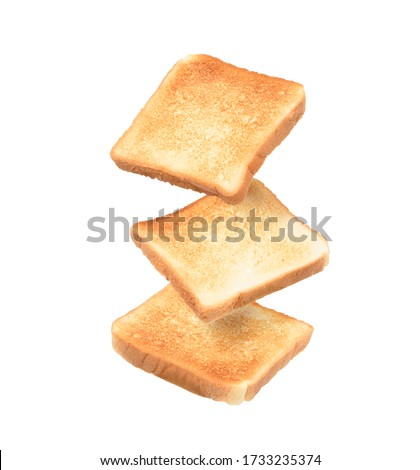 Stop motion image of drop toasted sliced bread stack isolated on white background. Foto stock ©